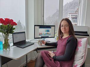 Devon at her remote workstation, working from home.
